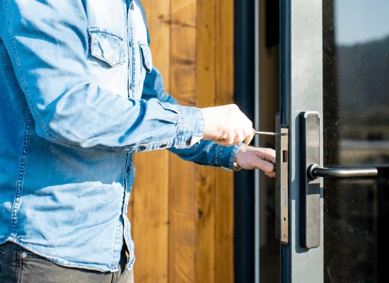 man fixing door housing construction defects